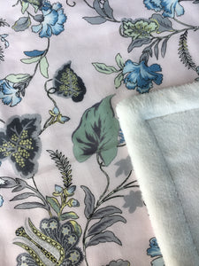 Tropical garden print minky blanket cotton front synthetic lining closeup shows printed cotton and folded corner to reveal minky lining