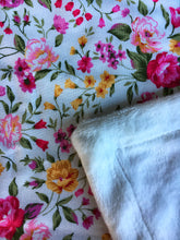 Load image into Gallery viewer, Dolls minky blanket cottn front synthetic minky back pink floral close up of fabric showing folded minky corner