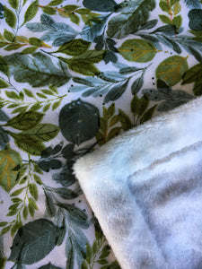 Dolls minky blanket cotton front synthetic minky back green leafy foliage print close up of fabric showing folded minky corner