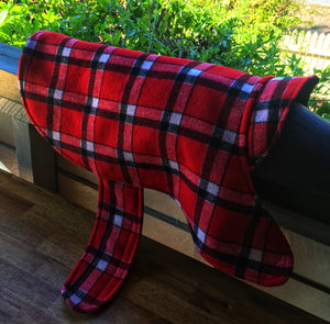 Morty is wearing his 90% wool dog coat. keeping warm and cosy in the cold winter temperatures. Featuring blanket style wool in red check and lined with 100% cotton.