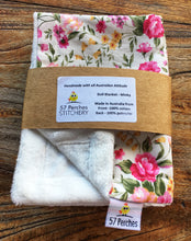Load image into Gallery viewer, Dolls minky blanket cottn front synthetic minky back pink floral folded and packed showing labels