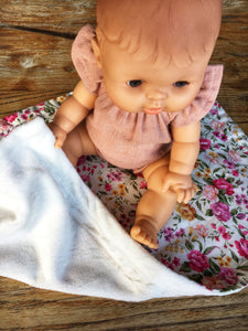 Dolls minky blanket cottn front synthetic minky back pink floral doll sitting on blanket