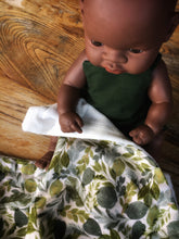 Load image into Gallery viewer, Dolls minky blanket cotton front synthetic minky back green leafy foliage print indigenous doll sitting with blanket over lap