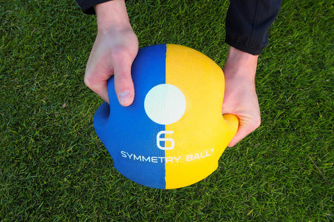 golf symmetry ball hand positioning guide delayed release
