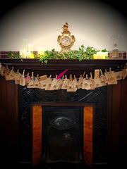 Decorated fireplace with festive decor on the mantlepiece and filled, numbered pouches hung below