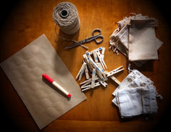 Supplies for crafting - plain stickers, pen, string, pegs, fabric pouches or envelopes and scissors