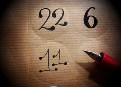 Plain stickers numbered by hand from 1 - 24