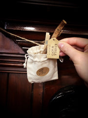 Shop Elf (staff member) filling up the fabric pouch with a sweet treat
