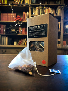 Image of Grimm's Restorative Brew Box, a kraft box with black labelling containing 15 red berry silk tea temples.