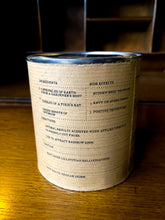 Load image into Gallery viewer, Image of a tin of Fourth Leaf of Clover with kraft paper label showing the faux ingredients and side effects on the back