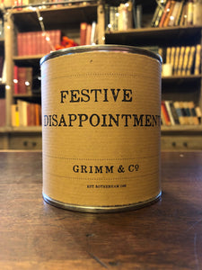 Image shows a tin of Festive Disappointment with kraft paper label.
