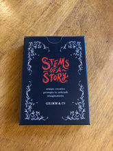 Load image into Gallery viewer, Image showing the front of the cardboard box for the card game Stems of a Story, created by children and young people during workshops at Grimm and Co.