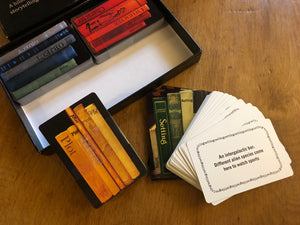 Image of the Twists and Tales cards partially out of the box, and displayed to see both sides of the cards. An example of one of the Setting cards can be read: 'An Intergalactic bar. Different alien species come here to watch sports.'