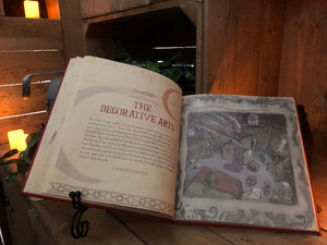 Image of The Book Of Wizard Craft laying open, showing the first page of Chapter 2 and an illustration.