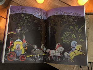 Detail image of some of the illustrations contained inside the book, with a different illustrator for each story. This image shows Cinderella's horse-drawn carriage
