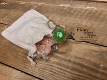 Load image into Gallery viewer, Image of a linen drawstring pouch labelled Edible Fairy Dust with a kraft paper label. Pouch is open to reveal bag inside containing coloured sherbet and a lollipop