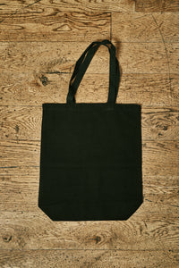 Image of back view of black cotton tote book bag