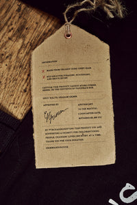Image of back of kraft paper label of Bag of Tricks