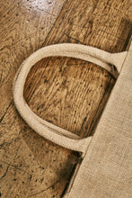 Load image into Gallery viewer, Close up image of the jute tote bag handles