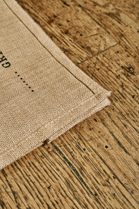 Image of the corner of a jute tote bag.