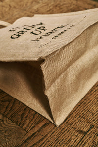 Image shows the bottom of the jute bag when opened.
