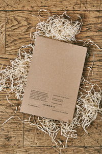 Image of the back cover of the How to Avoid Humans note book. Notebook is made from kraft card with white pages.