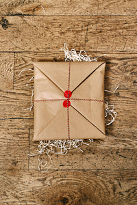 Image shows how the Human Disguises are wrapped when ordered in kraft brown paper and tied up with bakers twine and a kraft paper label.