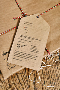Image shows how the Human Disguises are wrapped when ordered in kraft brown paper and tied up with bakers twine and a kraft paper label showing the size of the item.
