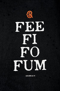 Close up image of black cotton t-shirt printing with white text saying 'FEE FI FO FUM' with a red Grimm & Co 'G' monogram at the top