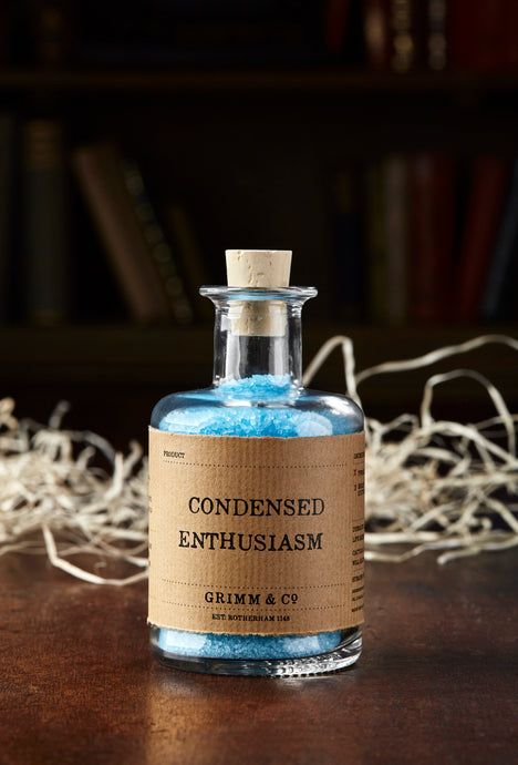 Image of Condensed Enthusiasm, otherwise known as scented, baby blue bath salts in a glass bottle with cork