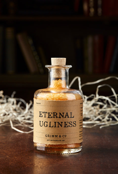Image of Eternal Ugliness, otherwise known as scented, orange bath salts in a glass bottle with cork