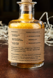 Image of the back label of A Pinch of Happiness otherwise known as scented yellow bath salts in a glass bottle with cork
