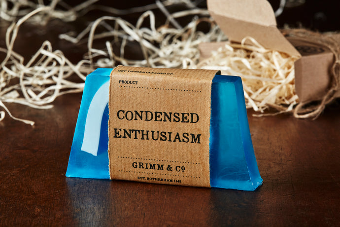 Image of Condensed Enthusiasm bar, otherwise known as an ocean scented soap slice, it is blue with a white wave shape inside the slice
