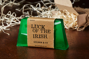 Luck of the Irish, otherwise known as a green, mango scented soap slice. Soap has white coloured soap strands suspended inside the green slice, and it is wrapped with a kraft label.