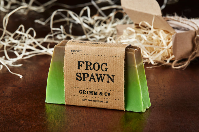 Image of Frog Spawn bar, otherwise known as a kiwi scented soap slice shown with kraft paper label