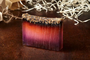 Image of 99% Phoenix Ash, otherwise known as lavender soap with lavender on top, shown without kraft label.