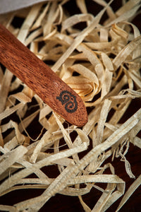 Close up detail image of the black Grimm & Co 'G' monogram imprinted into the base of the wand handle