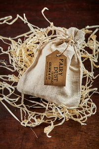 Image of a linen drawstring pouch labelled Edible Fairy Dust with a kraft paper label