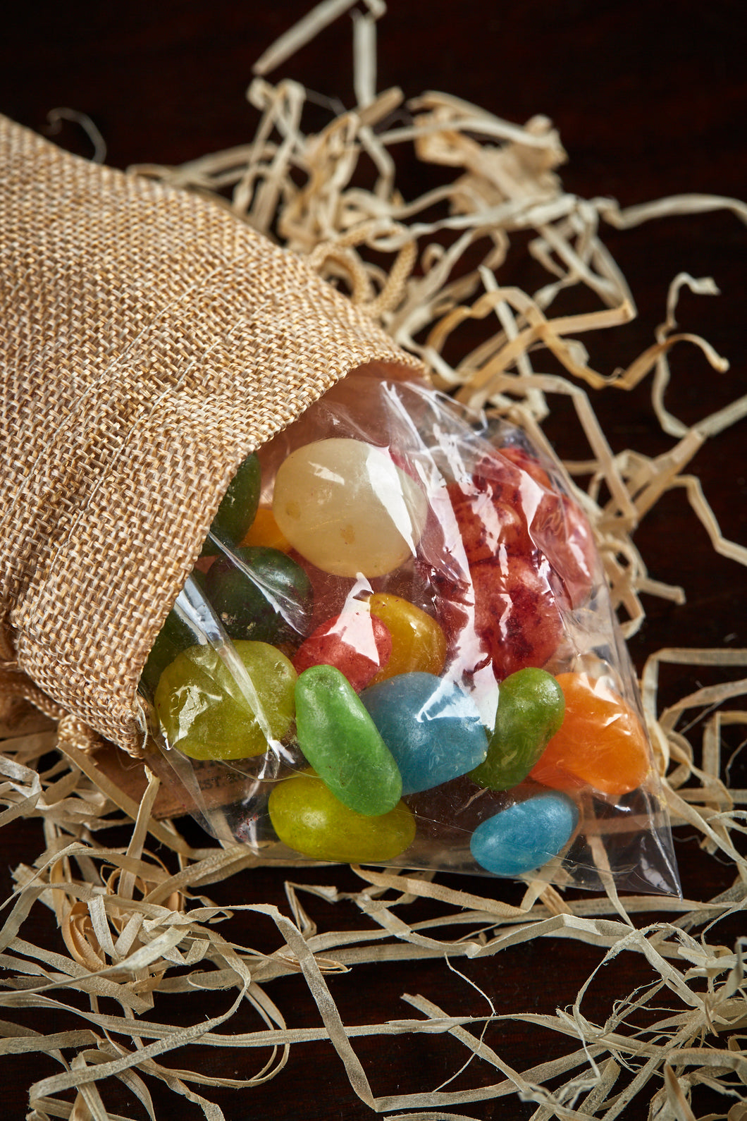 Image of Edible Magic Beans spilling out of the jute drawstring bag.