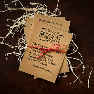 Image of the set of four kraft card quote and prompt cards, tied together with red twine.