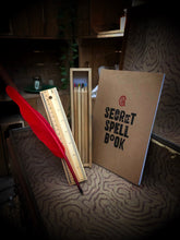 Load image into Gallery viewer, Image of all items in a study survival kit: a biro quill (red in this image), a secret spell book notebook, and a wooden pencil box with the sliding lid removed, showing the ruler it has on one side, and the coloured pencils inside the box.