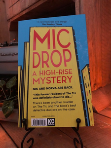Image shows the back cover of the paperback book Mic Drop written by Sharna Jackson and part of the High Rise Mystery series.