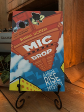 Load image into Gallery viewer, Image shows the front cover of the paperback book Mic Drop written by Sharna Jackson and part of the High Rise Mystery series.
