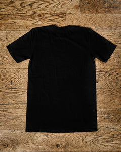 Image shows the plain back of the Human Disguise t-shirt made from black cotton