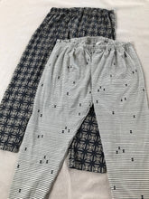 two pairs of pants in printed fabric arranged one on top of the other