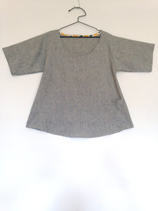 Tunic on a hanger in striped fabric