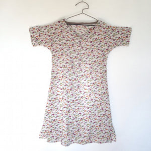 V-neck dress on hanger sewn in printed fabric