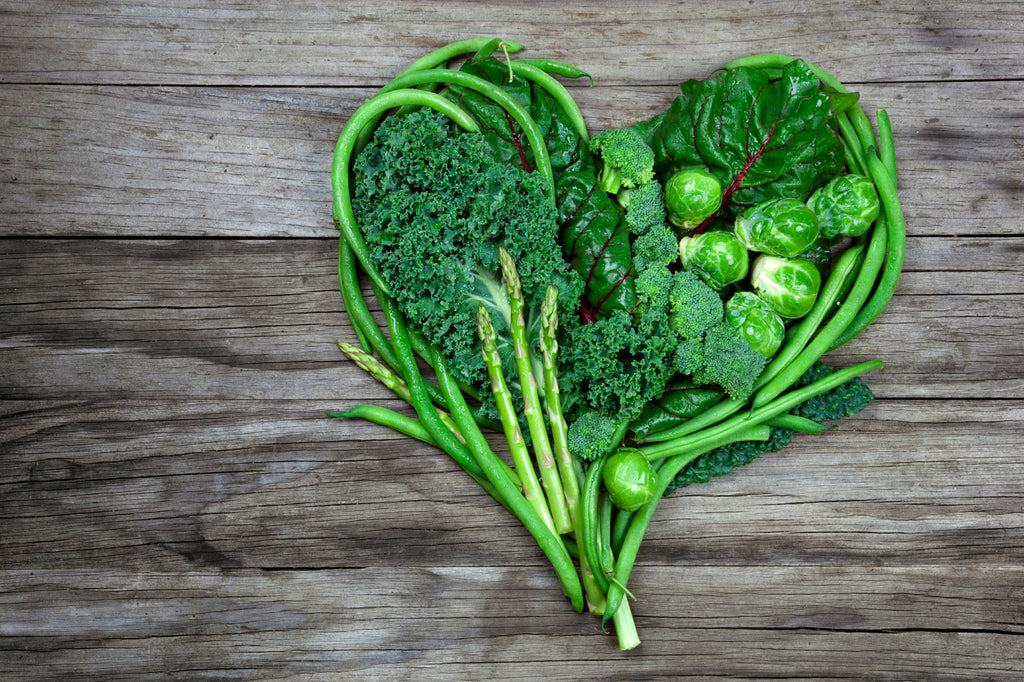 health benefits of greens - heart health - leafy greens in the shape of a heart