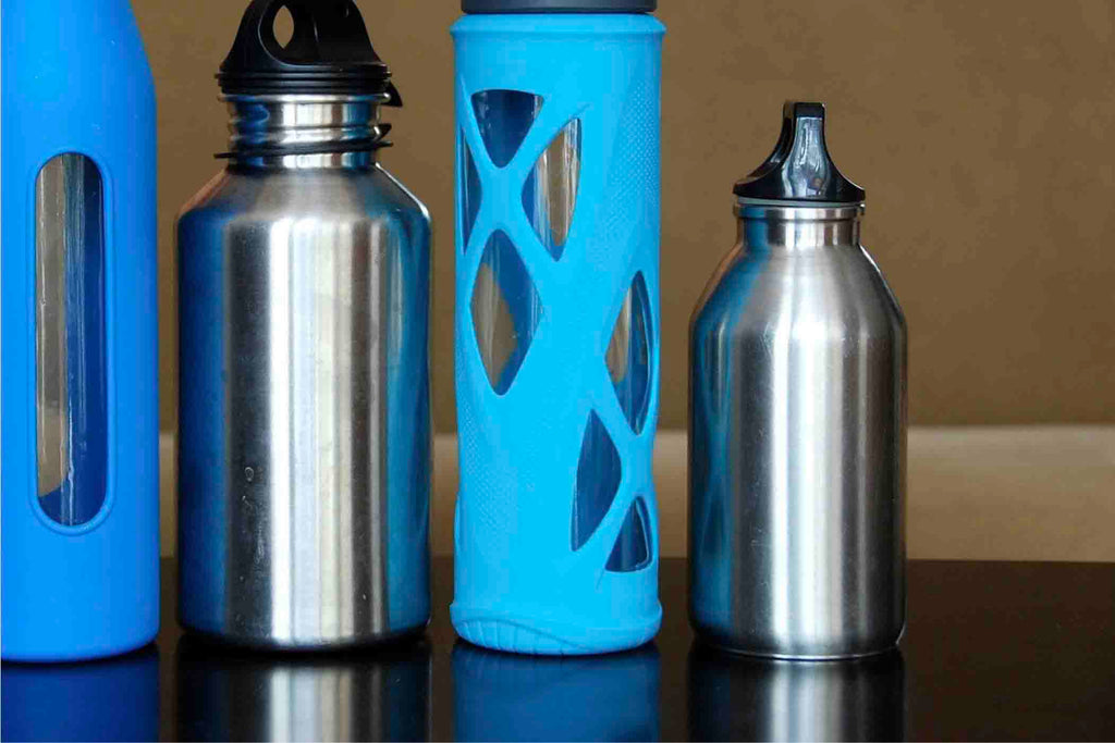 steel and blue colored reusable water bottles