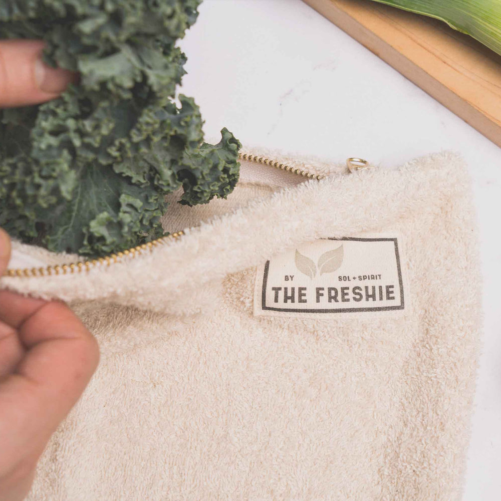 putting kale into the freshie food saver bag